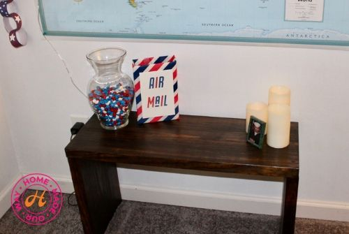 bench with jar of candy, box, photo, and candles