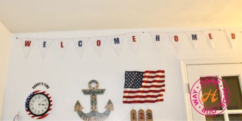 image of top portion of deployment wall with welcome home banner