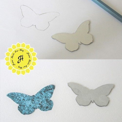 tracing and cutting out butterfly mirrors