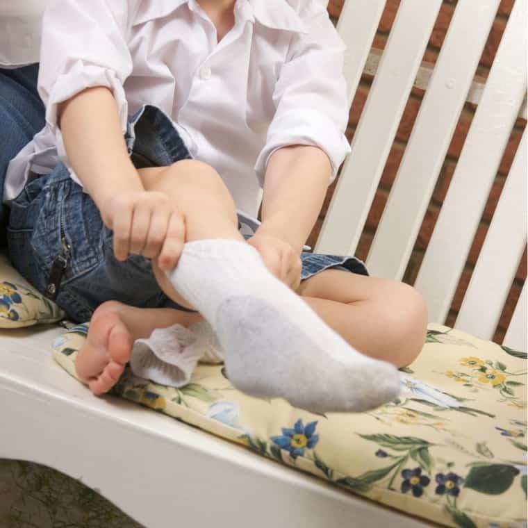 kid putting on socks
