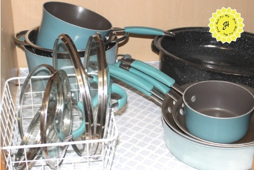 stacked pots and pans and lids