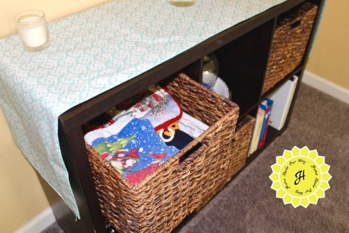 holiday dining linens in cube organizer basket