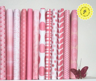 Books wrapped in pink scrapbooking paper