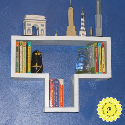 image of tetris shelf with books and lego cities