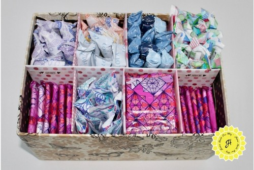 box with feminine care products sectioned and organized