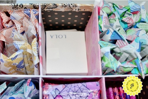 adding a filler to feminine products box for compact tampons