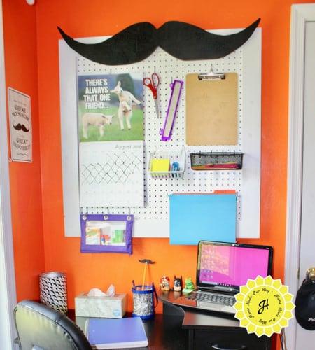 whimsical pegboard homework station above student desk