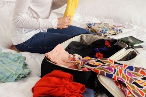 woman packing luggage for travel
