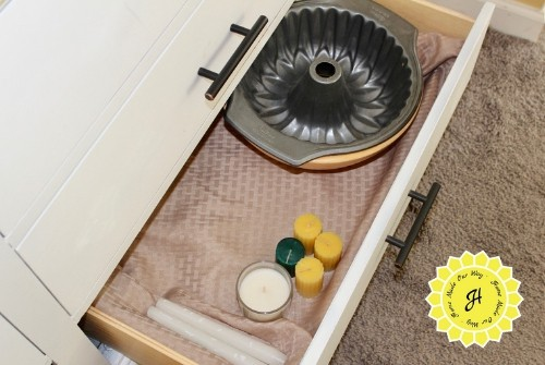 drawer with bowls and candles