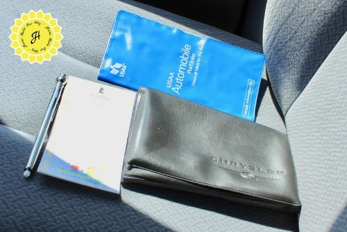 Contents of glove compartment: tire gauge, manuals, writing pad and insurance information