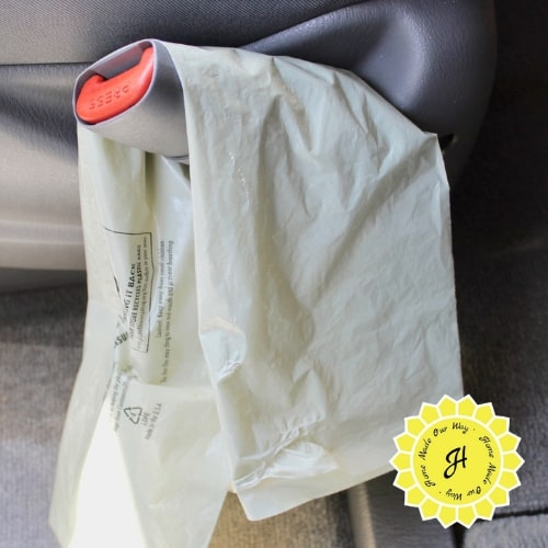 using a newspaper delivery sleeve as a trash receptacle in car