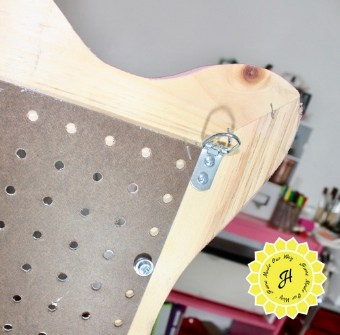 hanging hardware installed onto pegboard frame