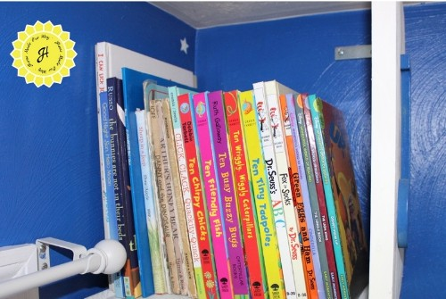 books placed in top tier of bookshelf tower