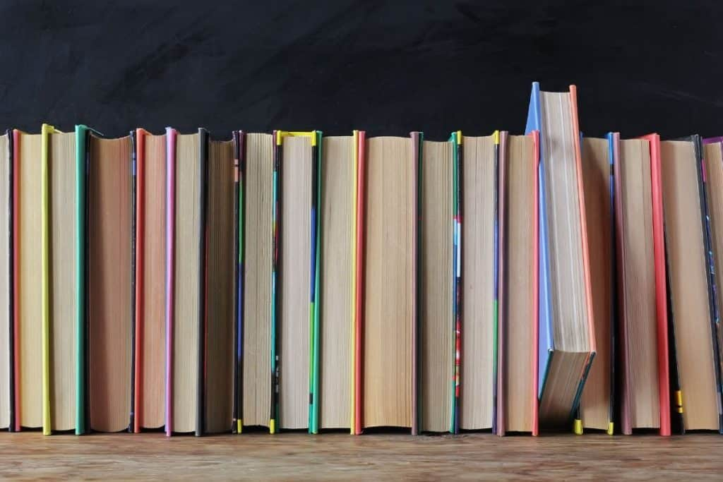 image of books on bookshelf with pages out spine in