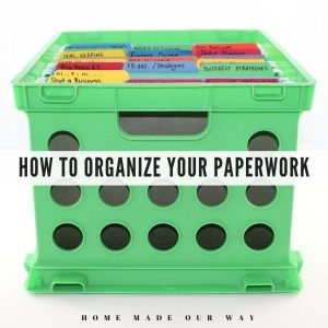 green crate holding file folders